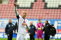 Mike van der Hoorn of Swansea City applauds the fans at the final whistle during the Sky Bet Championship match between Wigan Athletic and Swansea City at The DW Stadium in Wigan, England, UK. Saturday 2 November 2019