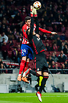 Goalkeeper Marinato Guilherme (R) of FC Lokomotiv Moscow fights for the ball with Jose Maria Gimenez de Vargas of Atletico de Madrid during the UEFA Europa League 2017-18 Round of 16 (1st leg) match between Atletico de Madrid and FC Lokomotiv Moscow at Wanda Metropolitano  on March 08 2018 in Madrid, Spain. Photo by Diego Souto / Power Sport Images