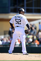 Detroit Tigers pitcher Jose Alvarez (52) during a spring training game against the Miami Marlins on March 13, 2014 at Joker Marchant Stadium in Lakeland, Florida.  Miami defeated Detroit 4-2.  (Mike Janes/Four Seam Images)