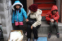People sit on staircase, Sendai, Japan. After the eartquake and tsunami a nuclear reactor exploded adding to woories of radiation spreading from the plant. The International Atomic Energy Agency confirmed that three reactors has partially melted down. <br /> 15  Mar 2011<br /> <br />