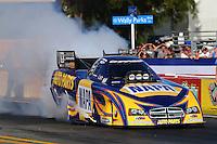 Nov 7, 2013; Pomona, CA, USA; NHRA funny car driver Ron Capps during qualifying for the Auto Club Finals at Auto Club Raceway at Pomona. Mandatory Credit: Mark J. Rebilas-