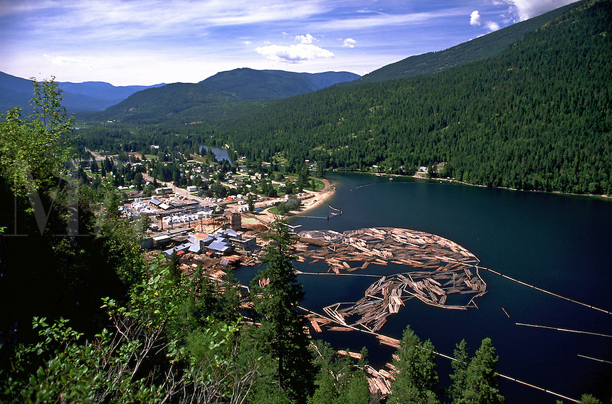 Aerial view of a Canadian lumber mill and log booms on Slocan Lake. Slocan, British Columbia (BC), Canada.