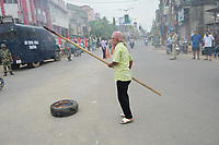Pictured: A Congress activists with a wooden stick.<br />  Re: Activists of the Congress political party clash with police in protest against price rises in oil, gas and other daily commmodities by BJP government in Agartala, in the Tripura area of India. Monday 10 September 2018