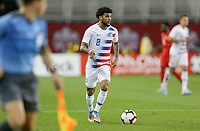 TORONTO, ON - OCTOBER 15: DeAndre Yedlin #2 of the United States looks for an open man downfield during a game between Canada and USMNT at BMO Field on October 15, 2019 in Toronto, Canada.