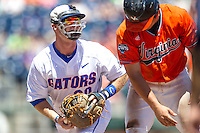Florida Gators first baseman Peter Alonso (20) in action against the Virginia Cavaliers in Game 11 of the NCAA College World Series on June 19, 2015 at TD Ameritrade Park in Omaha, Nebraska. The Gators defeated Virginia 10-5. (Andrew Woolley/Four Seam Images)