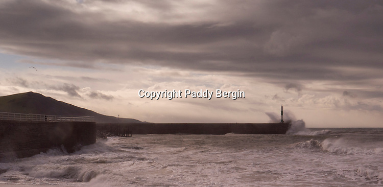 A view of the West Beach at Aberystwyth, Ceredigion, West Wales. Aber is a small seaside and University town and often receives atlantic storms with dramatic skies.<br /> <br /> Stock Photo by Paddy Bergin