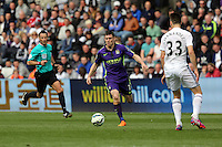 SWANSEA, WALES - MAY 17: James Milner of Manchester City (C) is running towards Federico Fernandez of Swansea (R) during the Premier League match between Swansea City and Manchester City at The Liberty Stadium on May 17, 2015 in Swansea, Wales. (photo by Athena Pictures/Getty Images)