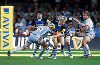 Photo: Richard Lane/Richard Lane Photography. Bath Rugby v Leicester Tigers. Aviva Premiership. 01/10/2011. Bath's Nick Abendanon is tackled by Tigers' Geoff Parling.