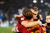 Roma s Daniele De Rossi, back to camera, celebrates with his teammate Edin Dzeko at the end of the Italian Serie A football match between Roma and Lazio at Rome's Olympic stadium, 18 November 2017. Roma won 2-1.<br /> UPDATE IMAGES PRESS/Riccardo De Luca