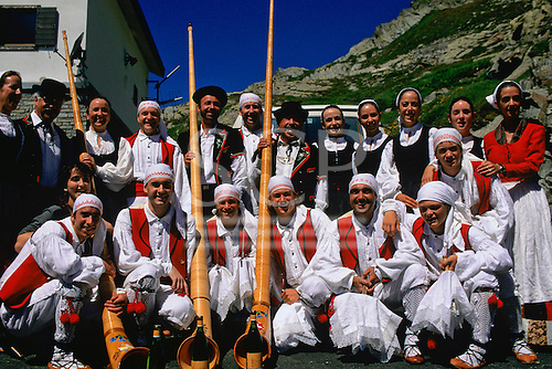 Nr St Bernard, Switzerland. Group of people in traditional clothes; alpen horns.