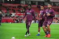 Nathan Dyer, Wayne Routledge and Cameron Carter-Vickers of Swansea City during the pre-match warm-up of the Sky Bet Championship match between Stoke City and Swansea City at the Bet 365 Stadium in Stoke on Trent, England, UK. Tuesday 18 September 2018
