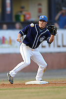 Asheville Tourists third baseman Matt Wessinger #16 takes the throw from the catcher during a game against the  Kannapolis Intimidators at McCormick Field on May 9, 2013 in Asheville, North Carolina. The Intimidators won the game 13-12. (Tony Farlow/Four Seam Images).