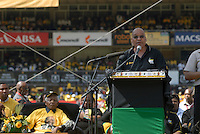 Nelson Mandela sits listening as Jacob Zuma addresses an African National Congress (ANC) election rally held at the Ellis Park Stadium in Johannesburg..