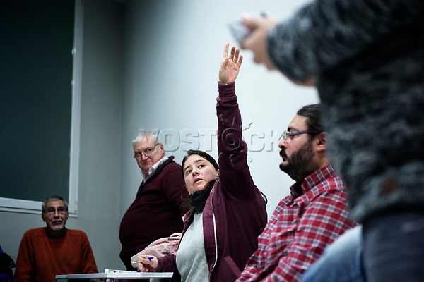 Madrid, Spain, February 12, 2015. A member of the left wing [party] Podemos asks to speak during their weekly meeting in Salamanca's neighbourhood in Madrid.