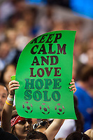 """A United States (USA) fan holds up a sign reading """"Keep Calm and Love Hope Solo"""". The women's national team of the United States defeated the Korea Republic 5-0 during an international friendly at Red Bull Arena in Harrison, NJ, on June 20, 2013."""