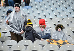 Ballyea  fans wrap up from the rain before the All-Ireland Club Hurling Final against Cuala at Croke Park. Photograph by John Kelly.