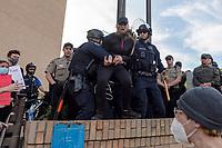 AUSTIN, TEXAS - MAY 30, Austin Police officers grab a terrified female protester into custody at the Black Lives Matter protest rally on May 30, 2020 in Austin, Texas.<br />