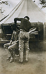 St Louis Mo:  View of a Philippine soldier getting a hair cut in the Philippine Village.