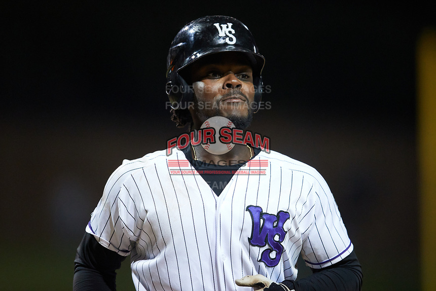 Jeremiah Burks (4) of the Winston-Salem Dash returns to the dugout after hitting a home run against the Bowling Green Hot Rods at Truist Stadium on September 9, 2021 in Winston-Salem, North Carolina. (Brian Westerholt/Four Seam Images)