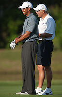 PONTE VEDRA BEACH, FL - MAY 5: Tiger Woods and caddie Steve Williams enjoy a light moment on the 5th fairway during Tiger's practice round on Tuesday, May 5, 2009 for the Players Championship, beginning on Thursday, at TPC Sawgrass in Ponte Vedra Beach, Florida.