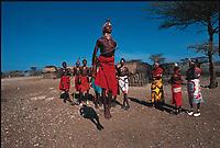 Samburu warriors and women performing mating dance. Sypalek Village, Shaba National Reserve, Kenya.