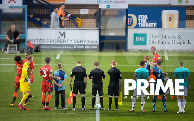 The teams head onto the pitch during the Carabao Cup 2nd round match between Wycombe Wanderers and Forest Green Rovers at Adams Park, High Wycombe, England on 28 August 2018. Photo by Andy Rowland.