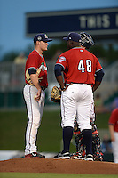 Fort Myers Miracle pitcher Kohl Stewart (2) and catcher Mitch Garver (hidden) listen to pitching coach Ivan Arteaga (48) during a game against the Tampa Yankees on April 15, 2015 at Hammond Stadium in Fort Myers, Florida.  Tampa defeated Fort Myers 3-1 in eleven innings.  (Mike Janes/Four Seam Images)