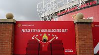 General view of a large sign on the approach to Old Trafford which reads, please stay in your allocated seat, as football clubs continue to observe the Covid guidelines during Manchester United vs Brentford, Friendly Match Football at Old Trafford on 28th July 2021