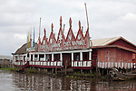 """The """"Expotel Ganvie Chez Raphael"""" is a bar-restaurant-hotel-souvenir shop.  Ganvie, Benin, with some 3,000 stilted buildings and a population of 20,000-30,000 people, may be the largest """"lake vllage"""" in Africa.  In Ganvie, the population lives exclusively from fishing, building houses on stilts in and next to Lake Nokoue.  Because the Dan-Homey religion prohibited attacks on communities living in the water, the village of Ganvie dates back to the 16th or 17th century, when it was built to protect people from slavery."""