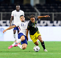 DALLAS, TX - JULY 25: Sebastian LLetget #17 of the United States attempts to strip the ball from Bobby Reid #10 of Jamaica during a game between Jamaica and USMNT at AT&T Stadium on July 25, 2021 in Dallas, Texas.