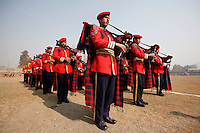 A military bagpipe police band plays ahead of a polo match in Srinagar, Kashmir, India. © Fredrik Naumann/Felix Features.
