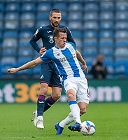 20th February 2021; The John Smiths Stadium, Huddersfield, Yorkshire, England; English Football League Championship Football, Huddersfield Town versus Swansea City; Jonathan Hogg of Huddersfield Town on the ball with Conor Hourihane of Swansea City in the background