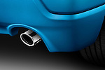 Detail closeup of a tailpipe exhaust system on a 2011 Mitsubishi Outlander Sport SE