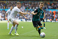 LEEDS, ENGLAND - AUGUST 31: (L-R) Luke Ayling of Leeds United15and Bersant Celina of Swansea City in action during the Sky Bet Championship match between Leeds United and Swansea City at Elland Road on August 31, 2019 in Leeds, England. (Photo by Athena Pictures/Getty Images)