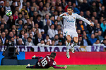 Cristiano Ronaldo (r) of Real Madrid jumps to avoid Anaitz Arbilla Zabala of SD Eibar during the La Liga 2017-18 match between Real Madrid and SD Eibar at Estadio Santiago Bernabeu on 22 October 2017 in Madrid, Spain. Photo by Diego Gonzalez / Power Sport Images