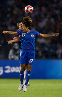 USWNT defender (17) Lori Chalupny goes up for a header against Japanese forward (17) Yuki Nagasato while playing at Worker's Stadium.  The USWNT defeated Japan, 4-2, during the semi-finals of the Beijing 2008 Olympics in Beijing, China.