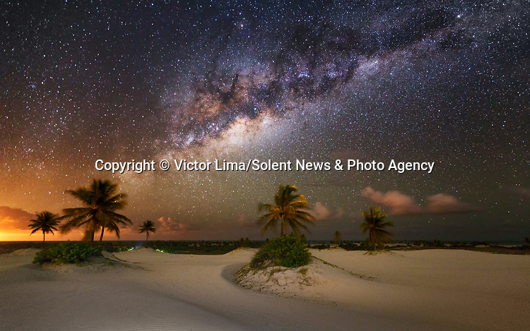 """Pictured: The night sky over Mangue Seco in Brazil.<br /> <br /> Photographs show incredible landscapes below a sky illuminated by stars. Away from cities and using long-exposure shots captures what cannot be seen with the naked eye of the night sky. <br /> <br /> The photos were taken across South America by landscape photographer Victor Lima. Mr Lima, 45, said: """"It is necessary to have a deep connection with nature to be able to understand a landscape you can't see with your own eyes."""" SEE OUR COPY FOR ME DETAILS<br /> <br /> Please byline: Victor Lima/Solent News<br /> <br /> © Victor Lima/Solent News & Photo Agency<br /> UK +44 (0) 2380 458800"""