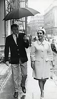 Elizabeth Taylor and Richard Burton outside the London Palladium, July 1963.