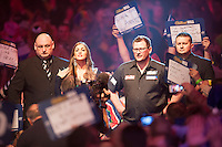 29.12.2014.  London, England.  William Hill World Darts Championship.  James Wade (6) [ENG] makes his way to the stage before his match against Stephen Bunting (27) [ENG]. Bunting won the match 3-1