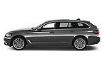 Car Driver side profile view of a 2021 BMW 5-Series Luxury 5 Door Wagon Side View