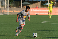 HARTFORD, CT - JULY 10: Matty Acosta #63 of New York Red Bulls II brings the ball forward during a game between New York Red Bulls II and Hartford Athletics at Dillon Stadium on July 10, 2021 in Hartford, Connecticut.