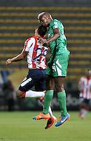 BOGOTA - COLOMBIA -25 -02-2015: Andres Murillo (Der.) jugador de La Equidad disputa el balón con Jorge Aguirre (Izq.) jugador de Atletico Junior, durante partido entre La Equidad y Atletico Junior por la fecha 6 de la Liga Aguila I-2015, jugado en el estadio Metropolitano de Techo de la ciudad de Bogota. / Andres Murillo (R) player of La Equidad vies for the ball with Jorge Aguirre (L) player of Atletico Junior, during a match La Equidad and Atletico Junior for the  date 6 of the Liga Aguila I-2015 at the Metropolitano de Techo Stadium in Bogota city, Photo: VizzorImage  / Luis Ramirez / Staff.