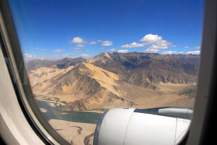 Descending between mountains to Gonggar Airport in the Yarlung Zangbo River valley, on the Tibetan Plateau, roof of the world, 3600 meters above sea level, 60 miles from Lhasa, Tibet.