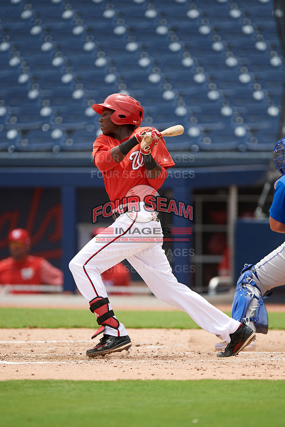 GCL Nationals third baseman Juan Pascal (19) at bat during the second game of a doubleheader against the GCL Mets on July 22, 2017 at The Ballpark of the Palm Beaches in Palm Beach, Florida.  GCL Mets defeated the GCL Nationals 4-1.  (Mike Janes/Four Seam Images)