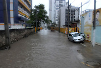 A driver is forced to abandon their car along a flooded road in Recife, Brazil as heavy rain causes severe flooding ahead of the USA vs Germany World Cup match