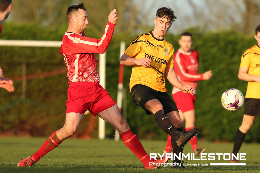 Rich McCarthy of Two Mile Borris in action against Ryan Lambe of Clonmel Town during the Tipperary Cup 1st Round game between Two Mile Borris and Clonmel Town  on Sunday 9th December 2018 at Newhill, Two Mile Borris Co Tipperary. Mandatory Credit: Michael P Ryan.