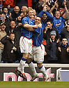 22/10/2005         Copyright Pic : James Stewart.File Name : jspa01 rangers v motherwell.CHRIS BURKE CELEBRATES WITH FERNANDO RICKSEN AFTER HE SCORES RANGERS FIRST IN THE FIRST MINUTE...Payments to :.James Stewart Photo Agency 19 Carronlea Drive, Falkirk. FK2 8DN      Vat Reg No. 607 6932 25.Office     : +44 (0)1324 570906     .Mobile   : +44 (0)7721 416997.Fax         : +44 (0)1324 570906.E-mail  :  jim@jspa.co.uk.If you require further information then contact Jim Stewart on any of the numbers above.........