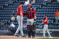 Rochester Red Wings catcher Jakson Reetz (15) greets relief pitcher Aaron Barrett (22) on the mound during the game against the Scranton/Wilkes-Barre RailRiders at PNC Field on July 25, 2021 in Moosic, Pennsylvania. (Brian Westerholt/Four Seam Images)