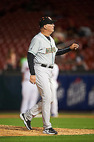 Norfolk Tides manager Ron Johnson (4) walks back to the dugout after making a pitching change during a game against the Buffalo Bisons on July 18, 2016 at Coca-Cola Field in Buffalo, New York.  Norfolk defeated Buffalo 11-8.  (Mike Janes/Four Seam Images)