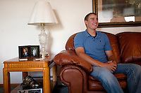 Brandon Nimmo shares a laugh as he's interviewed on Tuesday, June 21, 2011, in the living room of his parents' Cheyenne, Wyo. home. The New York Mets selected Nimmo No. 13 overall in the first round of this year's MLB draft. Now the recent high school grad must decide whether to go pro or accept an offer to play baseball at Arkansas in the fall. (Photo by James Brosher)